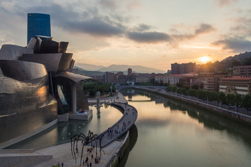 Bilbao, Spain - July  08, 2018- sunset view of modern and contemporary art Guggenheim Museum, designed by American architect Frank Gehry and inaugurated in October 1997