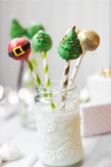 Christmas decorated cake pops; holiday background