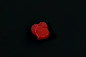 Red hearts on black background.