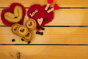 Red heart and cookies on wooden background.