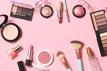 professional makeup tools. Makeup products on a colored background top view. A set of various products for makeup.