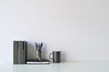 Mockup workspace desk and copy space books, coffee and pencil on white desk. Wall mural