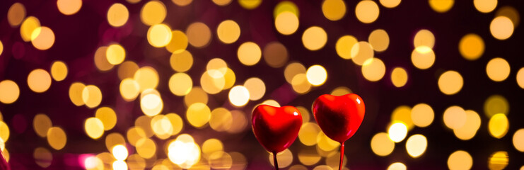 Banner with bokeh and two hearts. Valentine's day concept