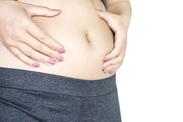 overweight woman hand holding big belly and stomach isolated on white background