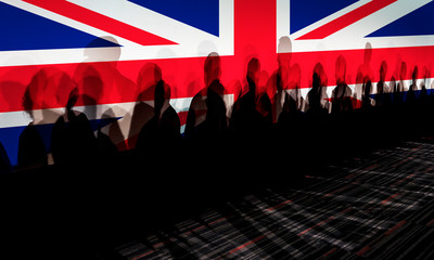 Lot of people shadows against UK flagged screen