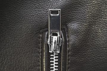 Zipper, lightning on black leather