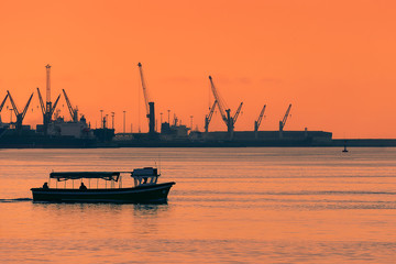 boat transporting people at sunset between Getxo and Portugalete