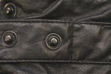 rivets in leather material