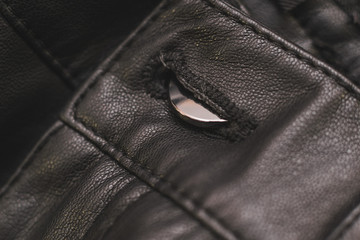 Stitches in black leather