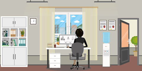 Office room with window,open door and modern furniture, female on workplace back view