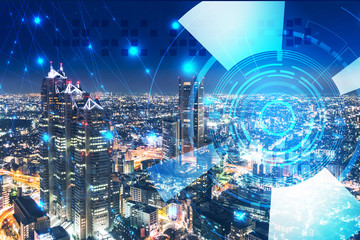 テクノロジーのイメージと都市の夜景