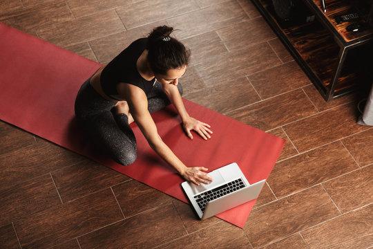 Beautiful healthy woman doing yoga exercises