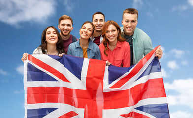 patriotism, citizenship and friendship concept - group of smiling friends with british flag over white background