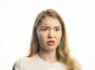 Isolated shot of young with shocked expression, receives bad news. Shocked woman stands on white background. Girl with bad emotions. Emotional expression.