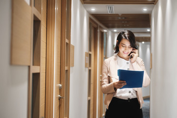 Young Businesswoman Working In Financial Agency Speaking On Cell Phone