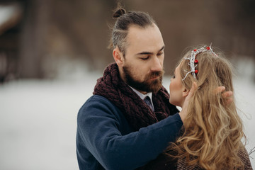 Portrait of young couple in love in a cold winter day. Love and couple relationships concept. Wedding day in Valentine day.