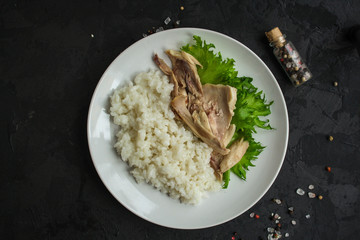 rice and boiled chicken meat. proper nutrition. food background. copy space