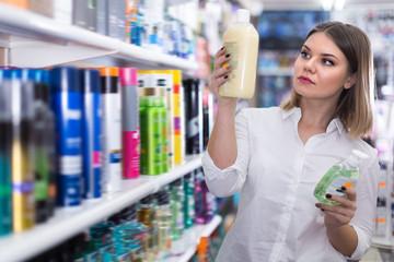 Nice girl choosing hair care treatments