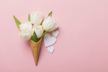 Flat-lay waffle cone with white flower blossom