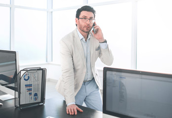 background image of a businessman in a modern office.