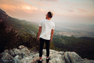 Guy on top of a mountain