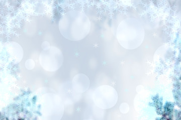 Abstract blurred festive winter christmas or Happy New Year background with shiny blue and white bokeh lighted stars. Space for your design. Card concept.