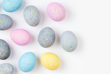 Background with pale pink, blue, yellow and gray Easter eggs. Compositions in pastel colors.  Easter concept