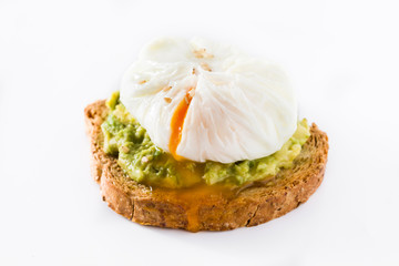 Avocado toast with poached egg isolated on white background.