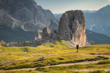 Morning view with man lookng on Cinque Torri mountain. Summer scene of Dolomiti Alps,