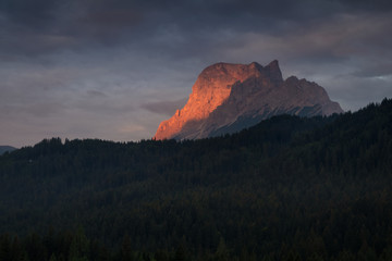 Famous Dolomites mountain peak glowing in beautiful golden evening light at sunset in summer, South Tyrol, Italy