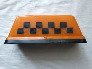 plafond of the car of the taxi of orange color with black squares, a retro, a side view, isolate...