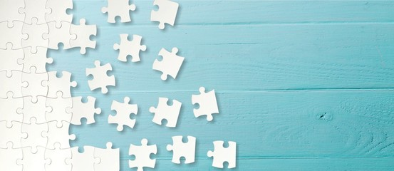 White puzzle pieces on blue background