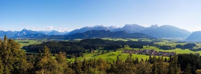 Alpine chain with Sauling, Tannheimer Berge and Allgauer Alps with Aggenstein, village Zell bei Eisenberg, view from Eisenberg Castle, Ostallgau, Allgau, Swabia, Bavaria, Germany, Europe