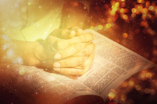 Woman Praying with Bible close up