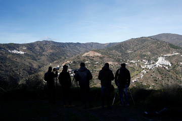 Photojournalists try to take pictures of a miner rescue team descending into a drilled well at the area where Julen, a Spanish two-year-old boy, fell into a deep well, in Totalan