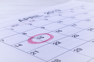 Calendar April, Circled day of 15. USA Tax Deadline, Due Date  Tax Day Reminder Concept photo.