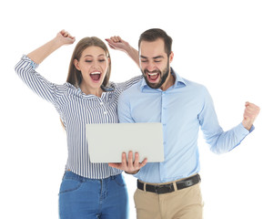 Emotional young people with laptop celebrating victory on white background
