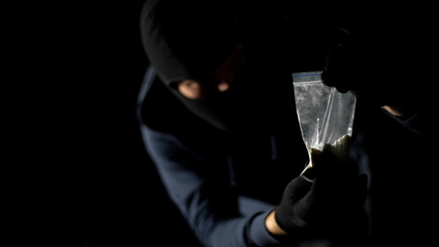 Addicted hooligan stealing drug package from dealers stash, robbery crime