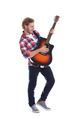 Young man playing acoustic guitar on white background