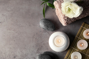 Spa composition with burning candles on table, flat lay. Space for text