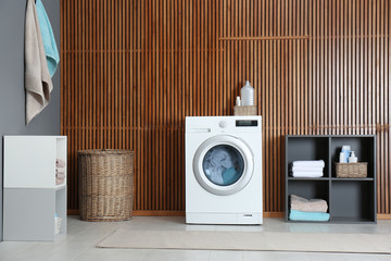 Washing of different towels in modern laundry room