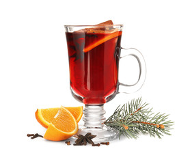 Deurstickers Cocktail Glass cup of mulled wine with fir branch and orange isolated on white