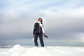 woman stand on top of a snow mountain