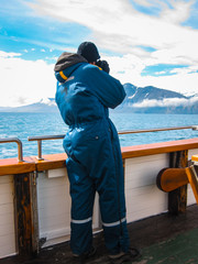 Photographer on a eco-friendly whale watching ship in Husavik, on the north coast of Iceland