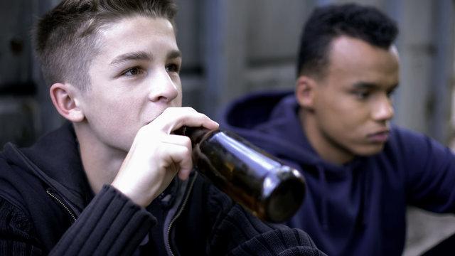 Problem teenagers secretly drinking beer, skipping school classes, hooligans