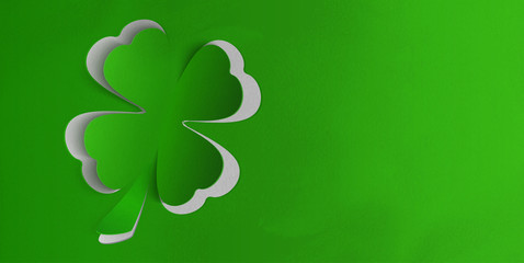 St. Patricks day background with clover. Paper texture with shadow.