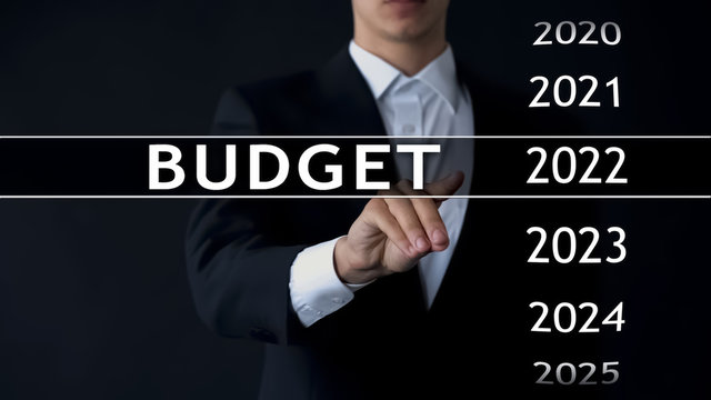 2022 budget, businessman selects file on virtual screen, annual financial report