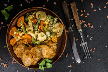 Fried chicken fillet with vegetables.