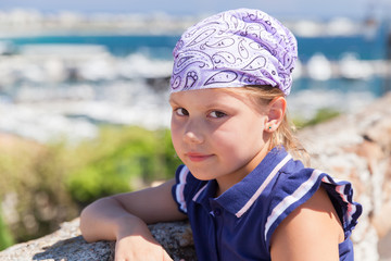 Cute Caucasian little girl in bandanna