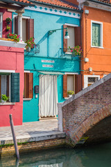 Exterior of colorful houses near canal